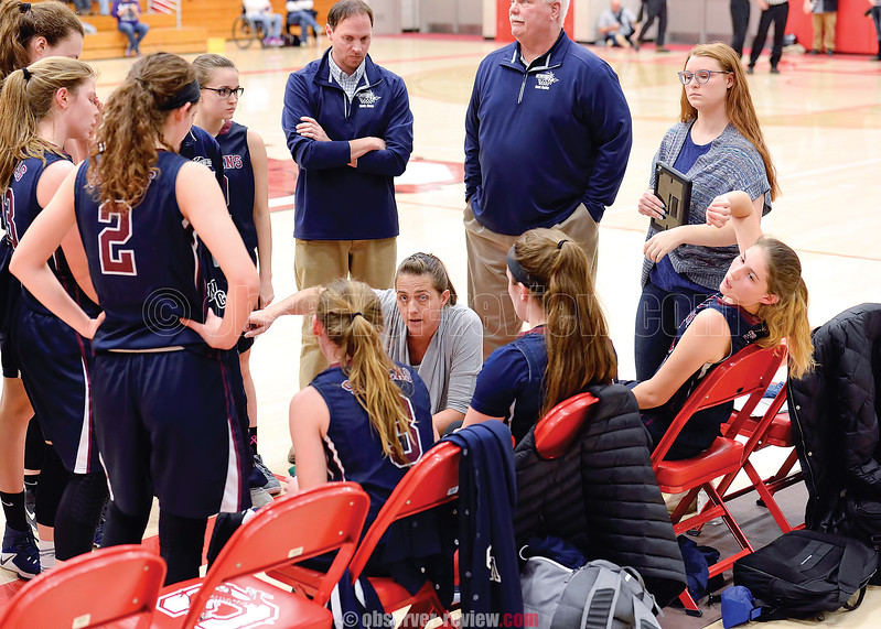Watkins Glen coach Alicia Learn talks with her team in the Class C final game. Don Romeo Photo
