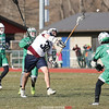 Long stick Ethan Voorheis runs the length of the field and takes a shot.