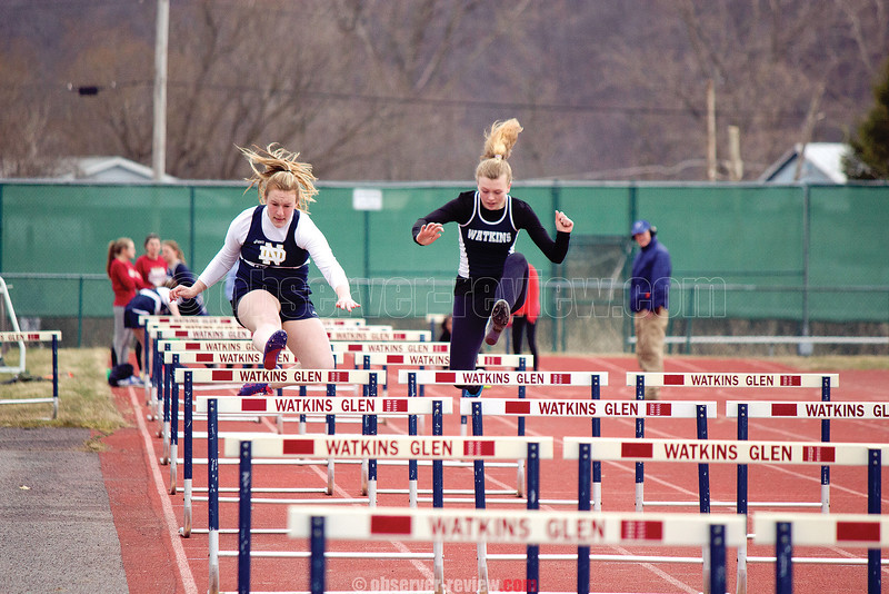 Watkins Glen's Kelsey Kernan leaps a hurdle during the meet. Photo by: Briana Taft