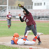 Megan Jenkins catches the ball at third base as a runner dives back Friday, April 27.