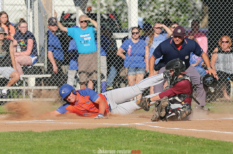 Nick Hoover avoids the tag at home plate as he scores against Wayland-Cohocton.