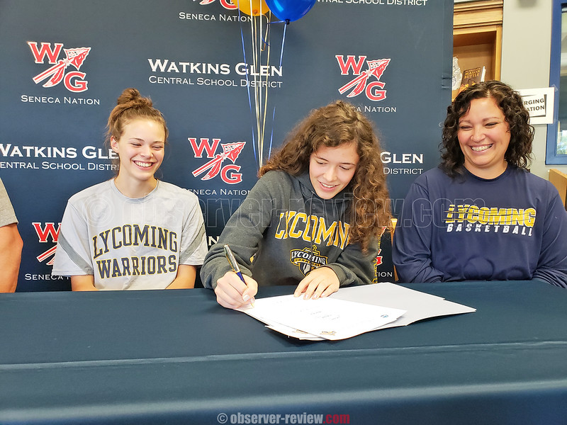 Ryanna LaMoreaux (center) signs with Lycoming College as sister Alexandria (left) and mother Rebekah Carroll (right) look on. PHOTO PROVIDED