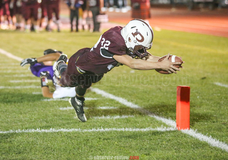 Dundee's Joshua Cramer dives into the end zone to score on a two-point conversion after also scoring the touchdown, Saturday night.