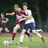 Paden Grover and Ayden Zahradnik battle at midfield in the game Friday, Sept. 14.