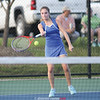 Molly Pullen volleys during the tennis match last week.