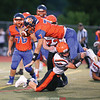 Will Rogers goes airborne to pick up additional yardage for Penn Yan on a quarterback keeper, Friday evening.