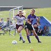 Dundee's Haille Empson charges in front of Hammondsport's Aubrie Cole during the soccer game, Friday, Aug. 31.