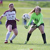Edele Morgan chases after the ball for Dundee as Megan Allen reaches to make a save for Hammondsport last week.
