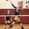 Adrienna Solomon jumps to clear the net for a spike last week.
