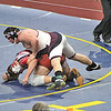 Dylan Houseknecht secures the final takedown in overtime to win the state title. Photo by: Bettelynn Bravo