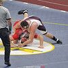 Dylan Houseknecht grapples with Newark Valley's Trentyn Rupert in the second period. Photo by: Bettelynn Bravo