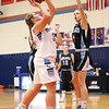 Ashley Sisson shoots for the Lady Mustangs Friday, Jan. 11, against Midlakes.