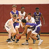 Odessa's Ryan Griswold and Jared Rumsey reach for a loose ball against Union Springs, Friday, Dec. 21.
