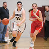 Dalaine Nolan advances the ball up court in the second half of the Friday night game. Dundee lost the game by one point.