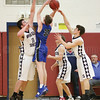 Collin Baker reaches to block a Candor shot during the game last week.