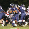 Travon Jones advances over the line of scrimmage during the homecoming game last week.