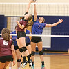 Dundee's Lily Hall goes up at the net against Penn Yan's Clarissa Enos, Monday evening, Sept. 30.