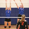 Paige Yonts and Jammie Decker jump to block a spike Saturday, Nov. 2.