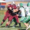 Kaden Labar (17) advances the ball with blocking by Hunter Crofoot (54), Saturday, Nov. 2.