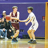 Dundee's Peyton Boudinot passes around Thomas Kressly in the game Wednesday, Dec. 4.