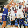 Jenna Solomon (30) and Adrienna Solomon (20) jump for a rebound against Lansing.