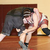 Travis Bailey initiates a takedown in the match last week.