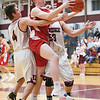 Michael Hand and Cameron Denmark defend the basket for Dundee last Friday.