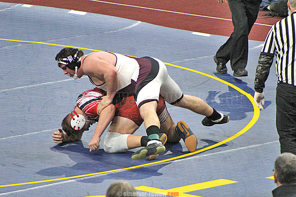 Dylan Houseknecht secures the final takedown in overtime to win the state title. Bettelynn Bravo Photo