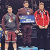 Dylan Houseknecht (center) won the New York state title at 285 pounds, Saturday, Feb. 23. NYSPHSAA Photo