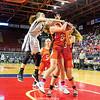 Kelsey Kernan battles for the ball under the basket last weekend.