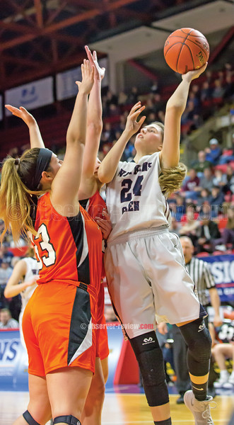 Taylor Kelly goes for a layup in the Sunday game. Photos by: Doug Yeater