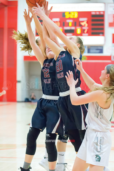 Kelsey Kernan and Adrienna Solomon jump for a rebound.