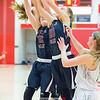 Kelsey Kernan and Adrienna Solomon jump for a rebound.