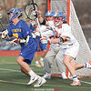 Jeff Kinyoun (back) and Jack Peterson (right) block the goal from a Cazenovia shot Thursday, April 4.