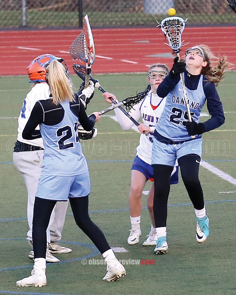 Goalie Alexandra Cox and Brady Logan defend in front of the goal last week.