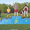 On the podium in Trumansburg last week is Watkins Glen's Casen Weeden (fourth place) and Odessa-Montour's Zach Elliott (first place).
