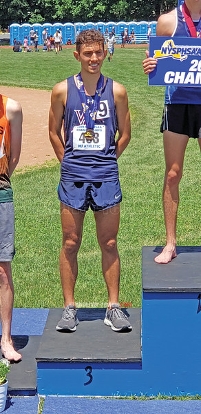 Gabe Planty on the podium at Middletown high school for the New York state tournament. PHOTO PROVIDED