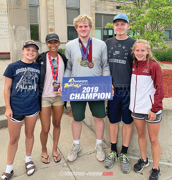 Odessa track athletes have a photo taken with champion Zach Elliott. From the left are Kennedey Heichel, Nadia Simpson, Elliott, Paden Grover and Tori Brewster. PROVIDED