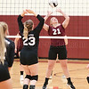 Jolynn Minnier sets the ball in the game against Spencer-Van Etten.