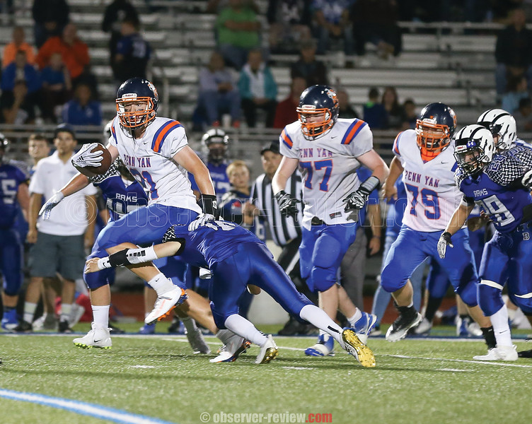 Penn Yan's Kyler Lloyd breaks a tackle to gain yardage for the Mustangs Friday, Sept. 6.