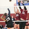 Hannah Chapman and Rhys Stermer go up at the net to block a spike Thursday, Sept. 5.