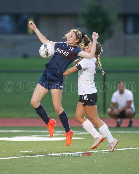Haley Dean jumps to take possession of a goal kick.