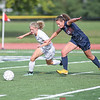 Odessa's Tori Brewster competes against Genevieve Osborne for Watkins in the game Wednesday, Sept. 18.