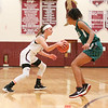 Sara Gardner drives to the basket in the game against Newfield.