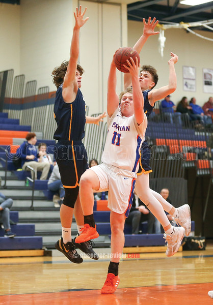 Brennan Prather works through traffic to shoot in the game, Friday, Jan. 10.