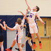 Kyle Berna jumps high to grab a rebound against Wayne.