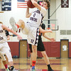 Isaac McIlroy pulls down a rebound in the Holiday Tournament at Watkins Glen.
