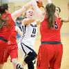 Abigail Gibson shoots for Watkins Glen while being double-teamed Saturday, Feb. 8.
