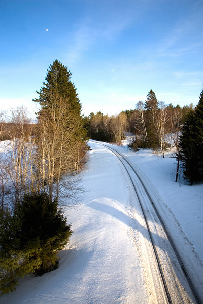 A railroad track leads off into the great white north. <br /> Photo by,<br /> Daniel Straine