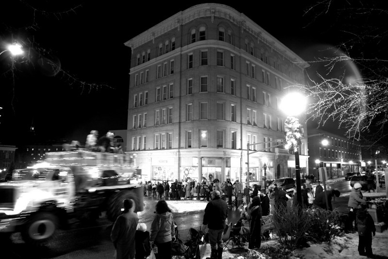 A week or so before Christmas my wife Erin and I bundled up and headed into Bangor, Maine for the annual Christmas Parade. I climbed up on top of the City Hall steps to create this image. It was a wicked cold one!<br /> Photo by,<br /> Daniel Straine